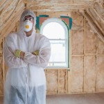 Man standing in protective suit after installing insulation
